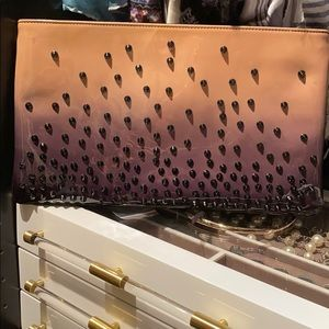 Christian Louboutin patent leather spiked clutch